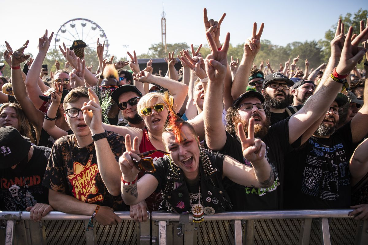 Fans cheer as Anti-Flag performs Friday afternoon at Riot Fest in Douglass Park.