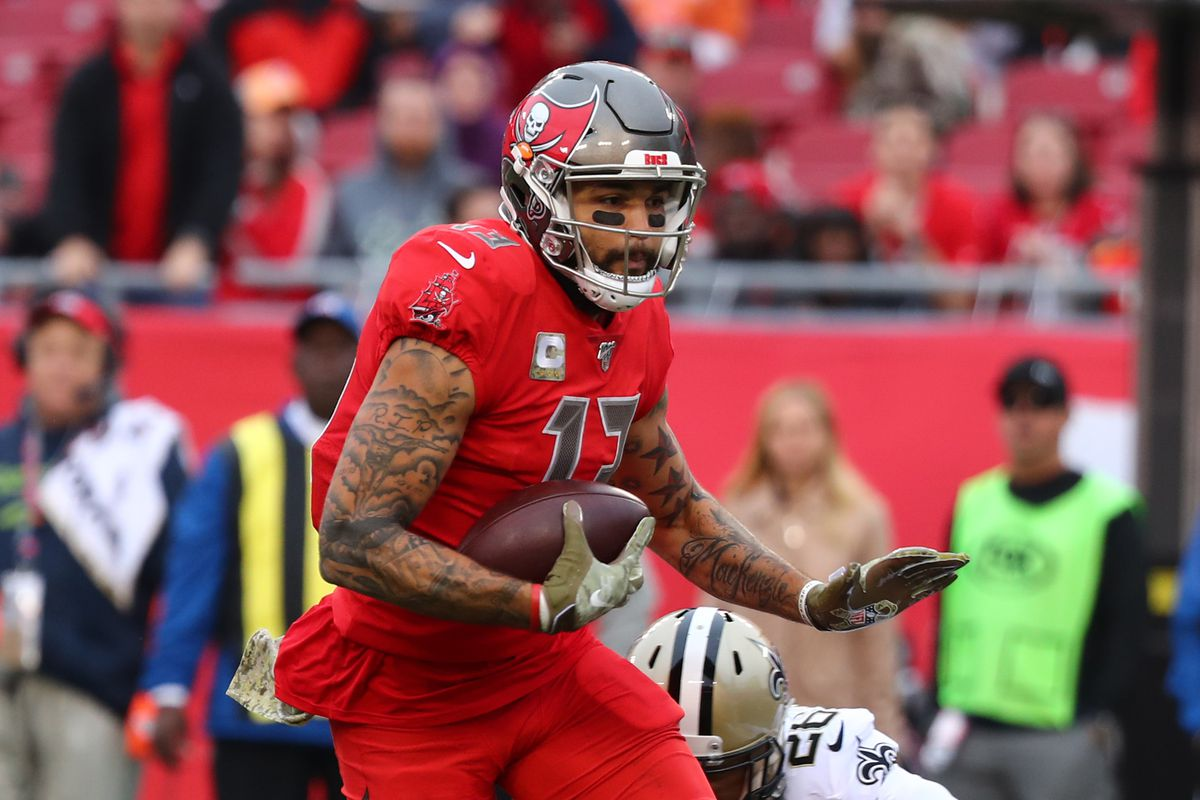 Tampa Bay Buccaneers wide receiver Mike Evans runs with the ball as New Orleans Saints cornerback P.J. Williams defends during the second half at Raymond James Stadium.