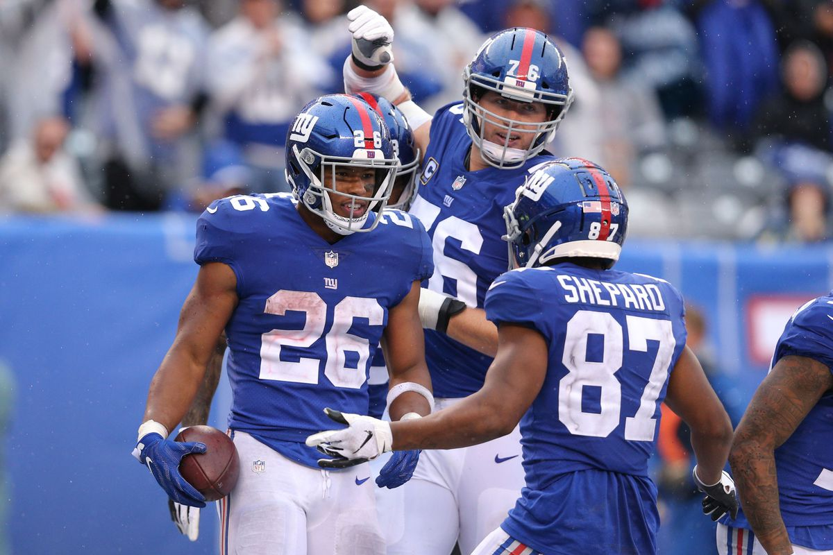 New York Giants running back Saquon Barkley celebrates his touchdown against the Jacksonville Jaguars with offensive tackle Nate Solder and wide receiver Sterling Shepard during the fourth quarter at MetLife Stadium.