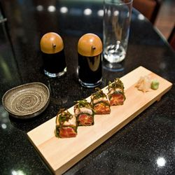 The Old City Market roll inspired by Charleston, S.C. has spicy tuna, seared salmon and wrapped in collard green