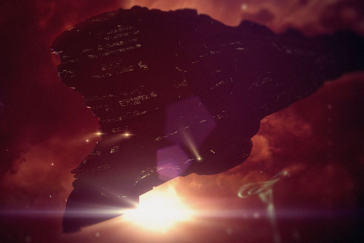 A massive capital ship eclipses a star in Eve Online.