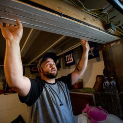 Casey Bolen shows where the beam in his family's home in Magna moved a few inches after a 5.7 magnitude earthquakehit early Wednesday, March 18, 2020.