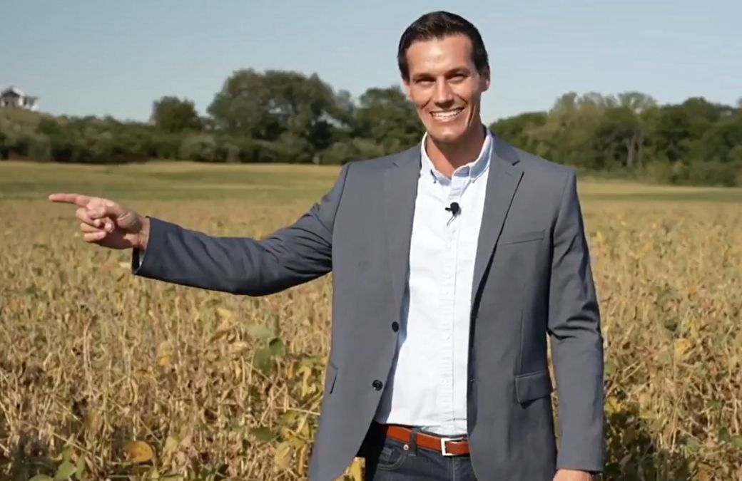 Republican candidate for governor Jesse Sullivan stands in soy bean field outside his home in downstate Petersburg, Ill.