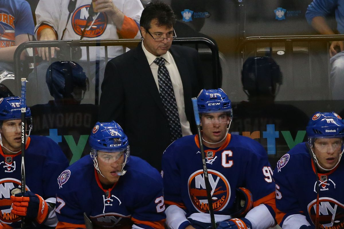In lieu of a picture being available from the 11/29 game, here's Jack Capuano in glasses behind the bench in a preseason game.