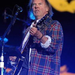 Musician Neil Young performs with his band Crazy Horse at the Global Citizen Festival in Central Park on Saturday Sept. 29, 2012 in New York.