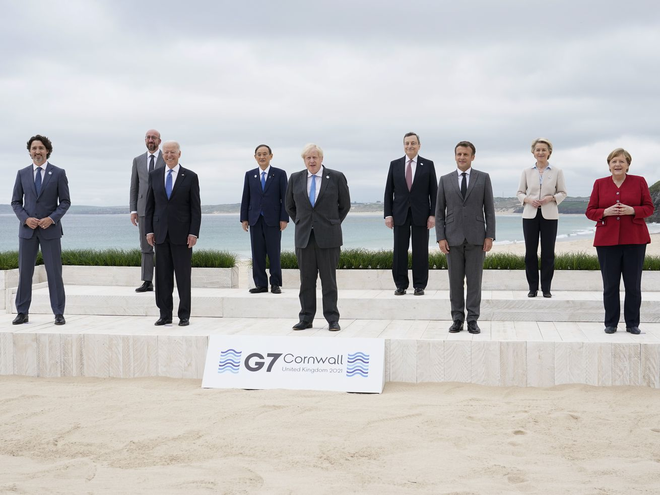 Leaders of the G7 pose for a group photo on overlooking the beach at the Carbis Bay Hotel in Carbis Bay, St. Ives, Cornwall, England, Friday. From left, Canadian Prime Minister Justin Trudeau, European Council President Charles Michel, U.S. President Joe Biden, Japan's Prime Minister Yoshihide Suga, British Prime Minister Boris Johnson, Italy's Prime Minister Mario Draghi, French President Emmanuel Macron, European Commission President Ursula von der Leyen and German Chancellor Angela Merkel.