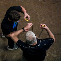 People switch off stopwatches at the 3A women's swimming state meet at the South Davis Recreation Center in Bountiful on Saturday, Feb. 13, 2021.