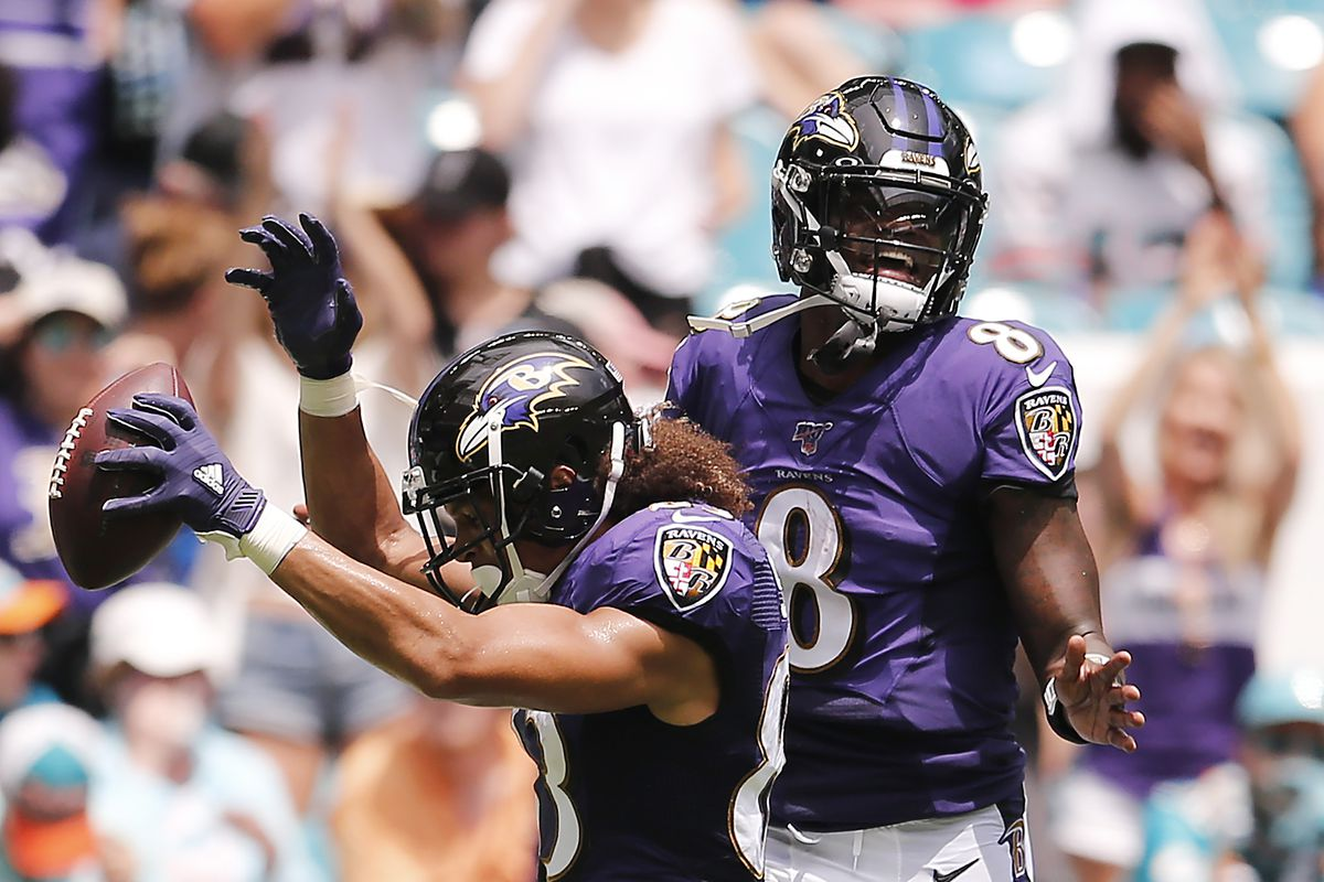 Willie Snead of the Baltimore Ravens celebrates with Lamar Jackson after scoring a touchdown against the Miami Dolphins during the second quarter at Hard Rock Stadium on September 08, 2019 in Miami, Florida.