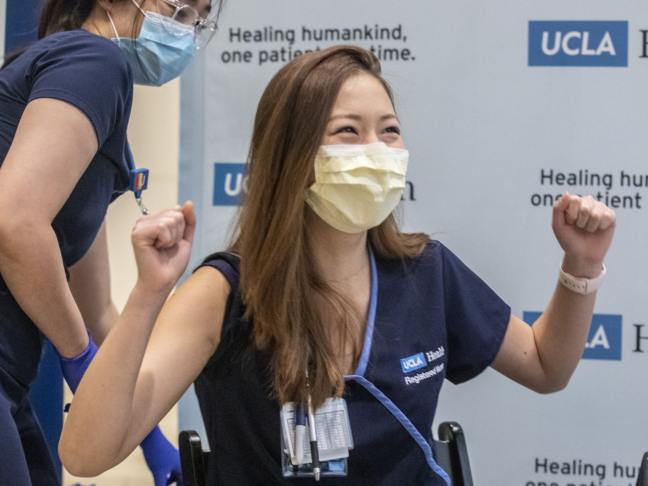 Nurse Nicole Chang celebrates after receiving one of the first injections of the COVID-19 vaccine at Ronald Reagan UCLA Medical Center.