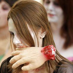 Zombie Walk participant Desiree Thompson strolls the streets of Salt Lake City on Sunday.