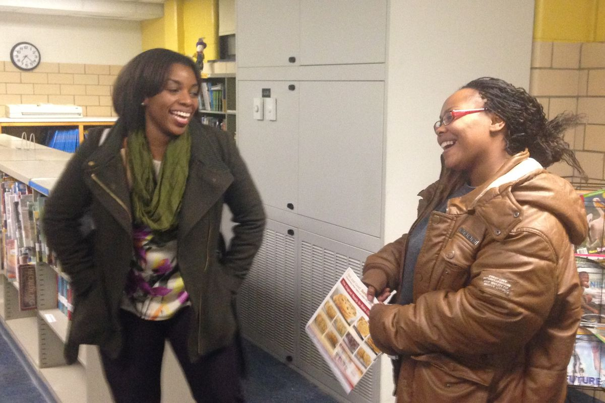 Shanae Staples, left, met with parents at School 69 Thursday to discuss her plan for restarting the school as Kindezi Academy.