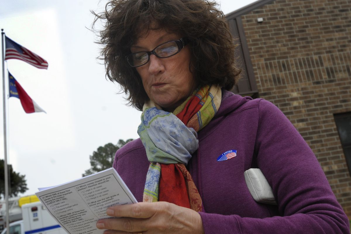 A woman fills out an exit poll after voting in the 2012 election.