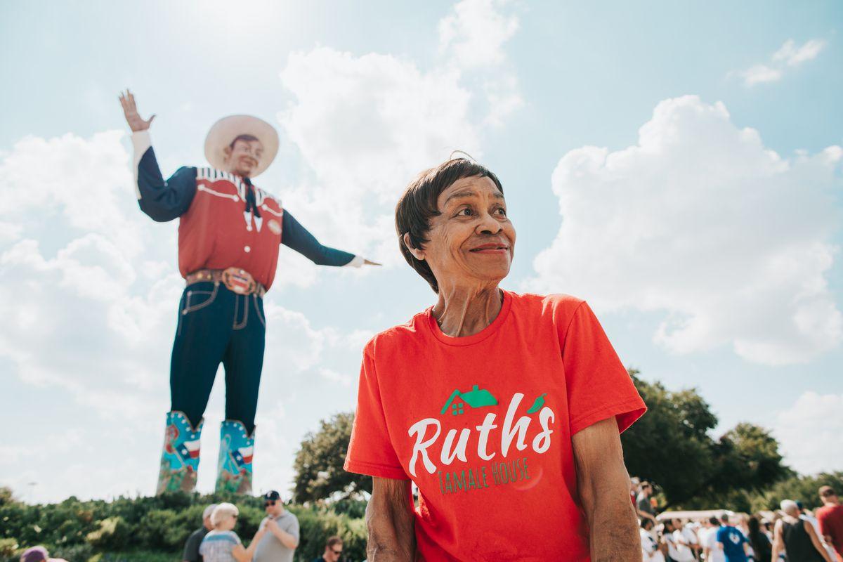 Ruth Hauntz stands in front of the Big Tex statue.