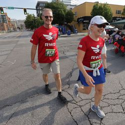 Kerry and Denise Checketts compete together during the Deseret News Half Marathon in Salt Lake City on Friday, July 23, 2021.
