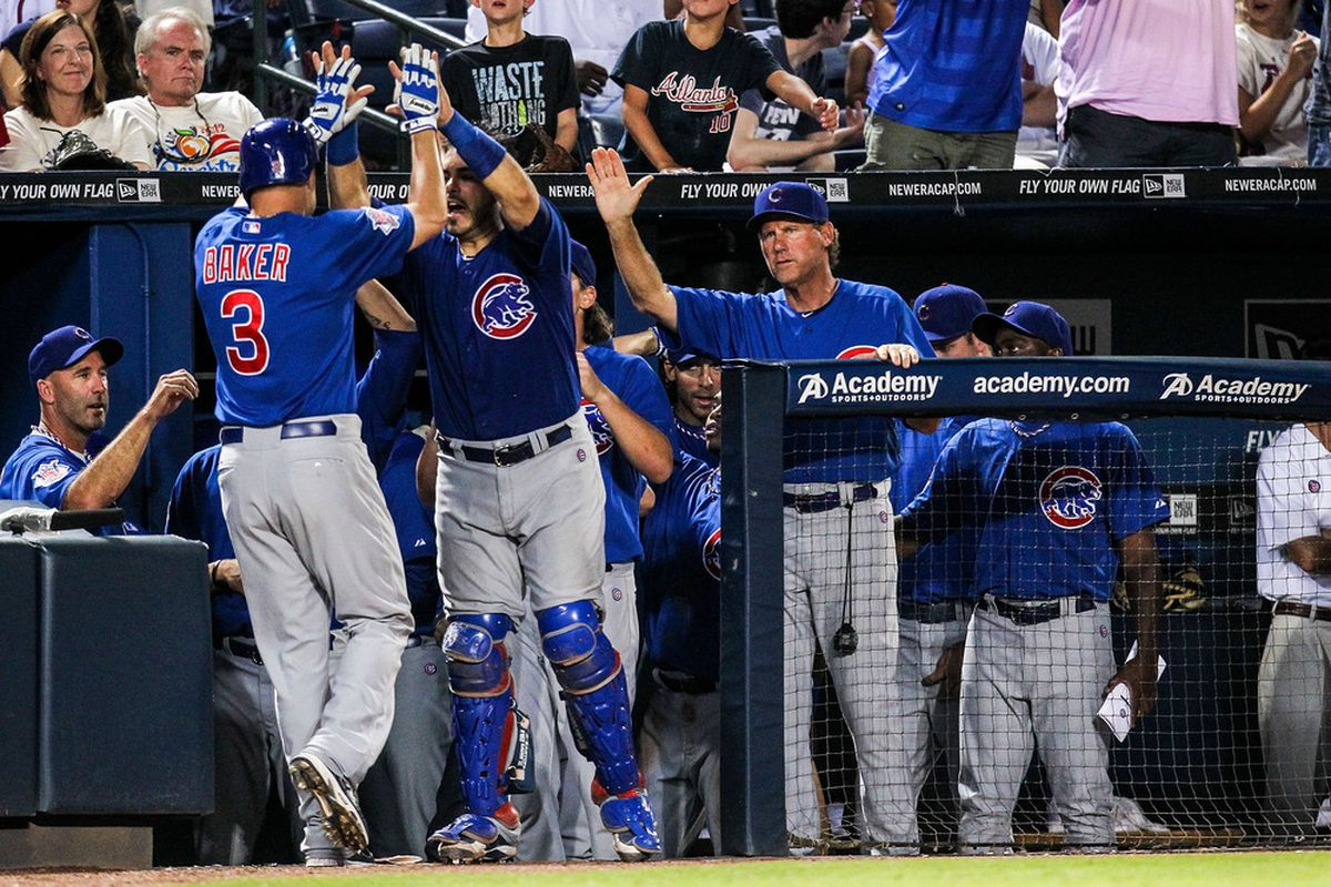 Atlanta, GA, USA; Chicago Cubs first baseman Jeff Baker celebrates hitting a home run with catcher Geovany Soto against the Atlanta Braves at Turner Field. Credit: Daniel Shirey-US PRESSWIRE