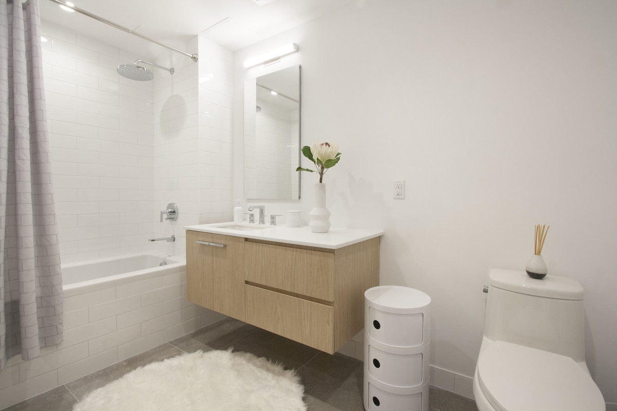 A bathroom with white walls.