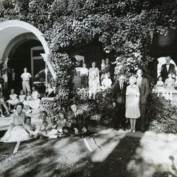 Sen. Robert F. Bennett had more grandchildren than any other senator in Congress. Shown with Senator and Mrs. Bennett are their 5 children and 20 grandchildren. Family groups, from left on porch, are Rosemary and Robert Fletcher, Mr. and Mrs. Wallace G. Bennett, Frances and Lawrence Jeppson. Seated on lawn are Dr. and Mrs. David W. Bennett, Robert and Joyce Bennett (standing).