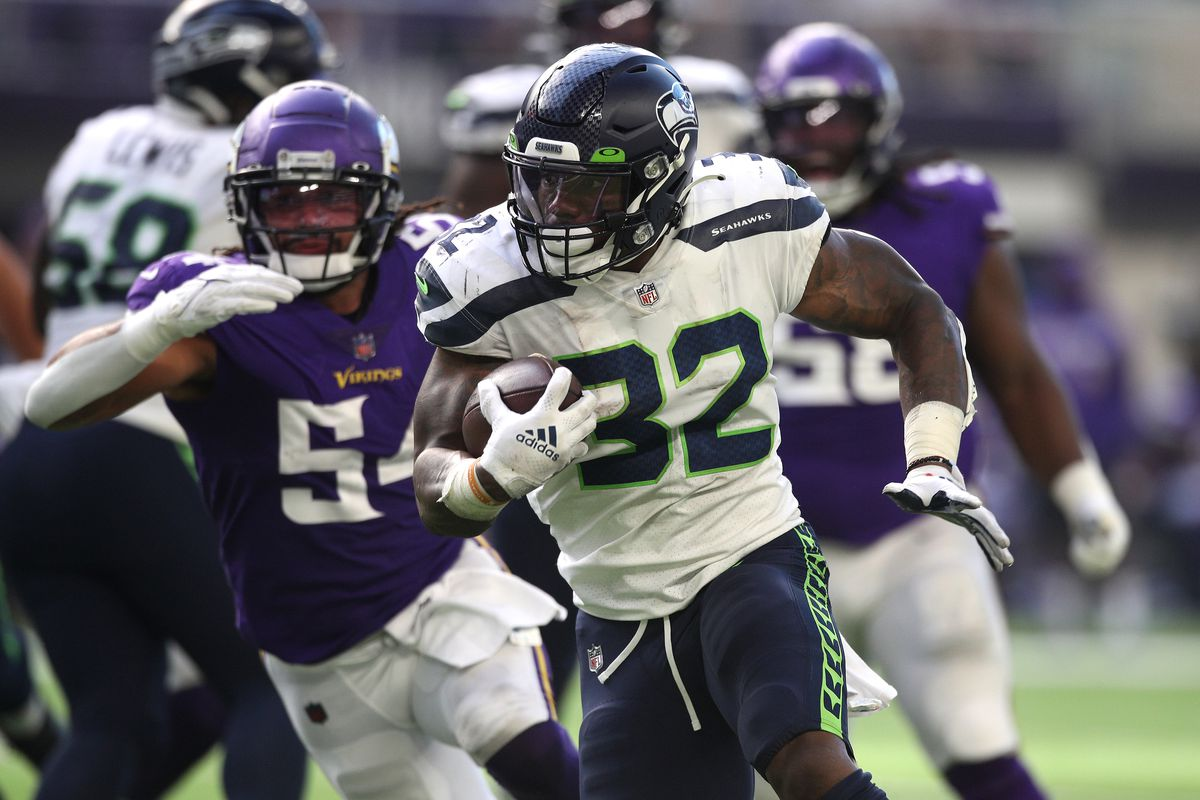 Chris Carson #32 of the Seattle Seahawks runs the ball for a touchdown during the second quarter in the game against the Minnesota Vikings at U.S. Bank Stadium on September 26, 2021 in Minneapolis, Minnesota.