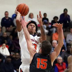 Oak Park's Isaiah Barnes (33) attempts a shot over Evanston's Blake Peters (15) during theri 79-69 loss in Oak Park,  Saturday, February 2, 2019. | Kevin Tanaka/For the Sun Times