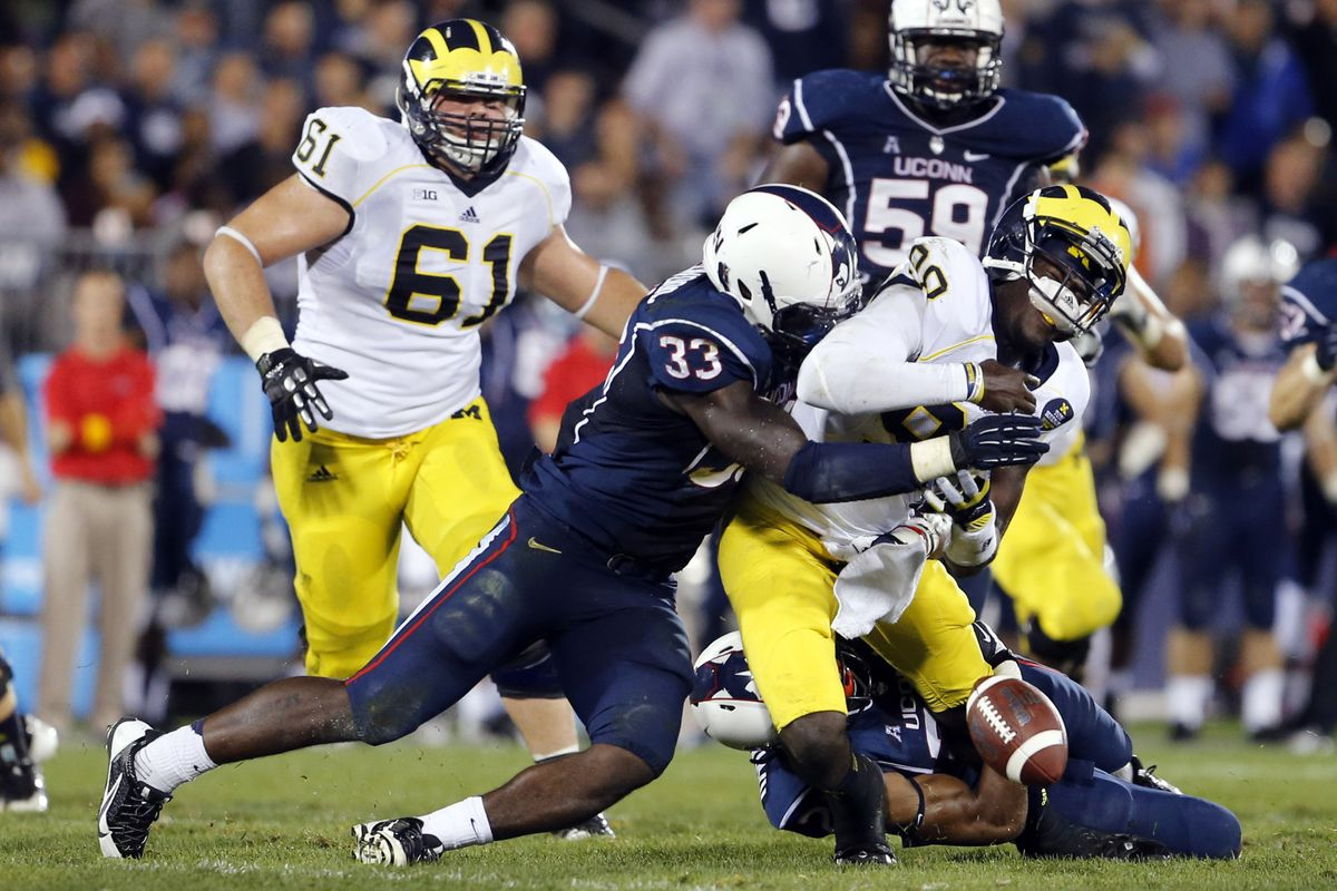 UConn Linebacker Yawin Smallwood forces a fumble against MIchigan in the Huskies' near upset of Michigan