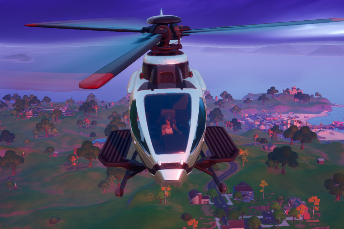 A Fortnite player flies high over the map in the game's helicopter