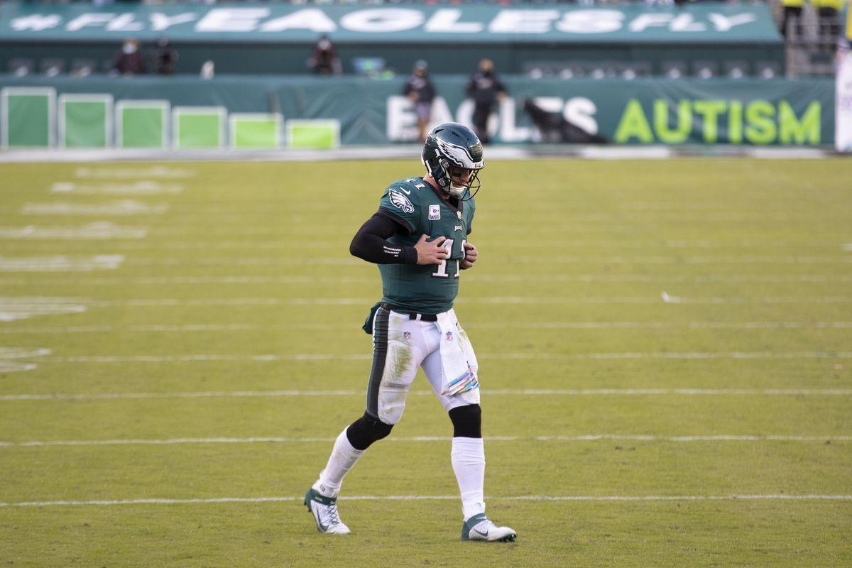 Carson Wentz of the Philadelphia Eagles walks to the huddle against the Baltimore Ravens at Lincoln Financial Field on October 18, 2020 in Philadelphia, Pennsylvania.