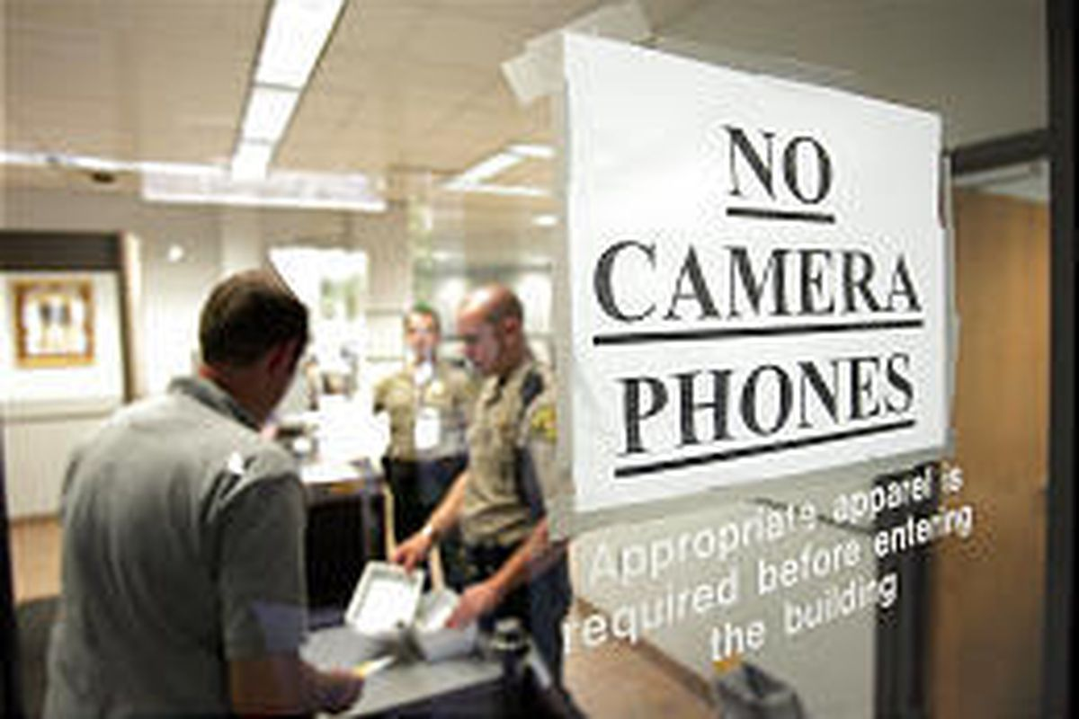 Door to 4th District Court in Provo is posted with a warning against camera phones. Cell users are asked to take the phones back to their cars.