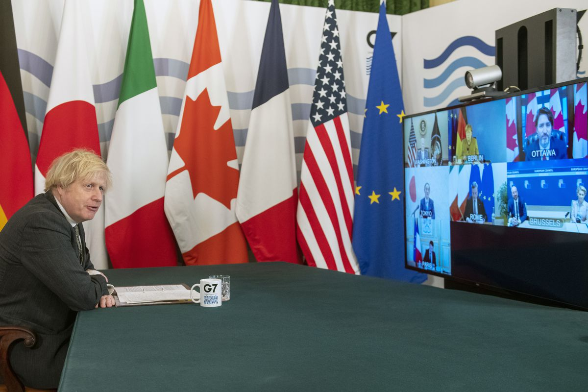 Britain's Prime Minister Boris Johnson hosts a virtual meeting of G7 world leaders, from within the Cabinet Room at Downing Street in London, Friday Feb. 19, 2021.