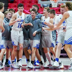Fremont celebrates their win over Layton in a 6A boys basketball semifinal game at the Huntsman Center in Salt Lake City on Friday, Feb. 28, 2020.