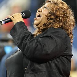 Aretha Franklin performs during a 2007 ceremony honoring the late tennis player Althea Gibson at the US Open. | AFP/Getty Images