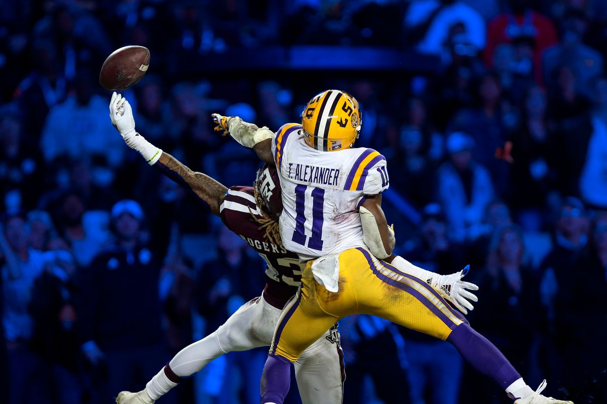LSU and Texas A&M played six overtimes in 2018. Here, a Tiger and an Aggie contest a pass.