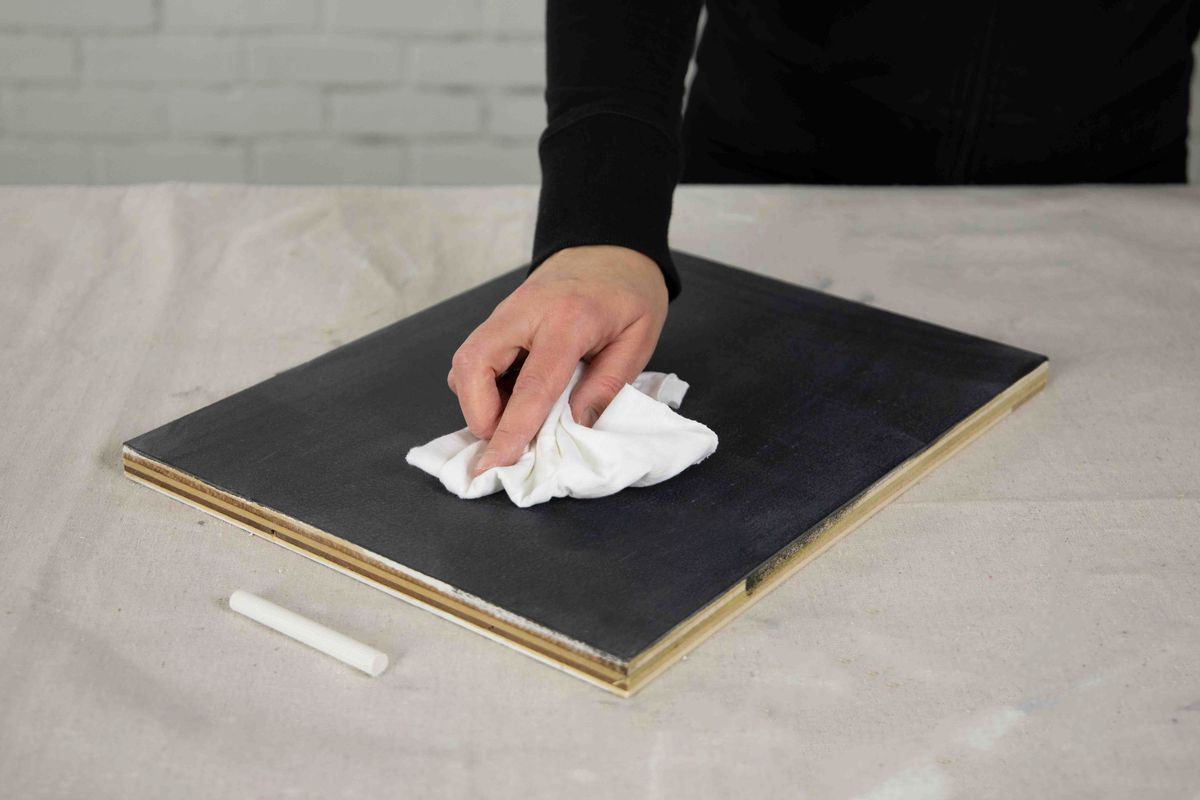 Cleaning chalkboard paint after applying it to bare wood