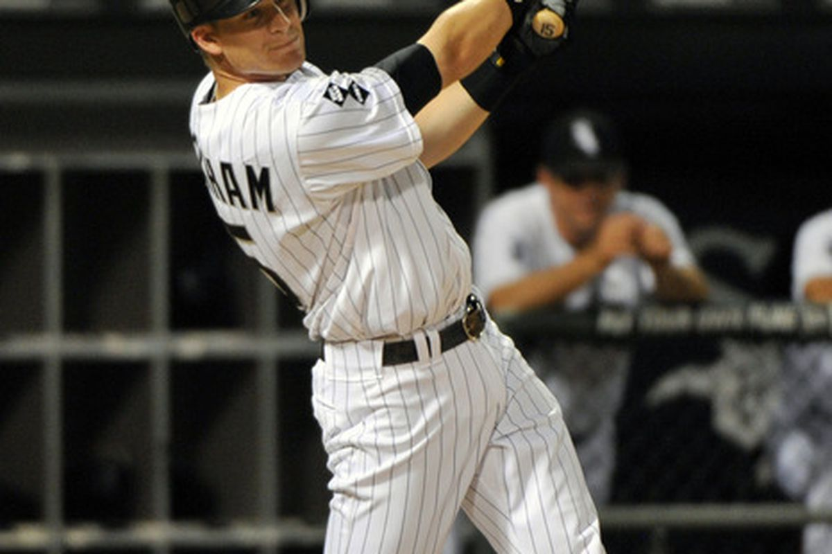June 20, 2012; Chicago, IL, USA; Chicago White Sox second baseman Gordon Beckham (15) hits a three run home run against the Chicago Cubs during the sixth inning at U.S. Cellular Field.  Mandatory Credit: Rob Grabowski-US PRESSWIRE