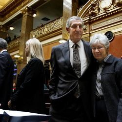 Recently retired Jazz coaches Jerry Sloan and Phil Johnson are honored in the House of Representatives at the Utah State Capitol on March 7, 2011. Gail Miller is comforted by Jerry Sloan as words by her late husband, Larry Miller, are recited.