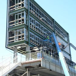 2:49 p.m. Panels being installed on the back of the right-field video board -