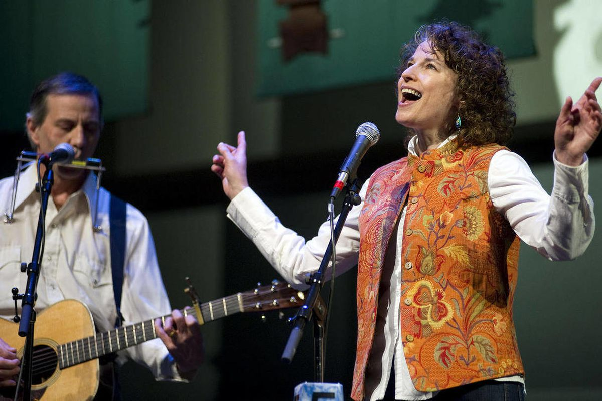 In this photo taken Monday, April 9, 2012, calling themselves the Busman's Holiday, Patricia Hull, right, and Riley Woodford perform during the first night of the Alaska Folk Festival in Centennial Hall in Juneau, Alaska. The free music festival runs nigh