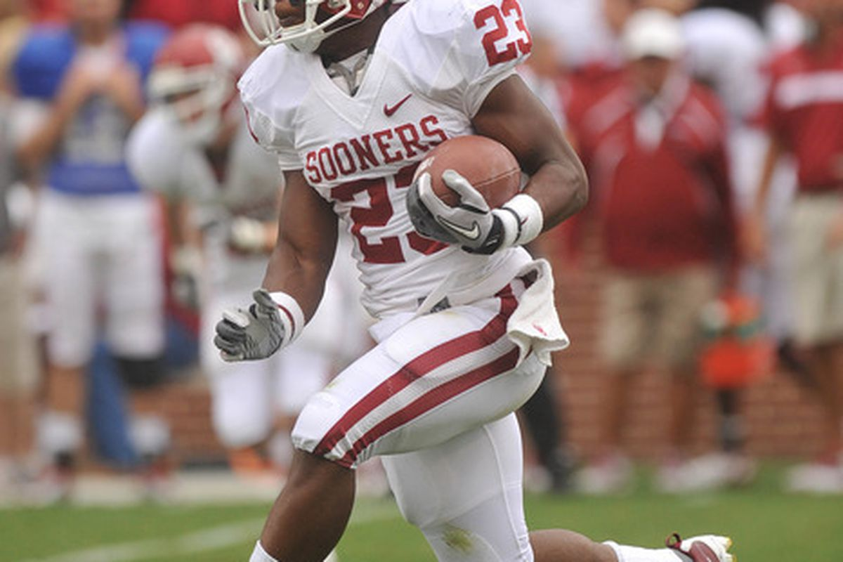 Apr 14, 2012; Norman, OK, USA; Oklahoma Sooners running back Danzel Williams (23) runs the ball during first half of the Oklahoma spring game at Gaylord Family Oklahoma Memorial Stadium. Mandatory Credit: Mark D. Smith-US PRESSWIRE