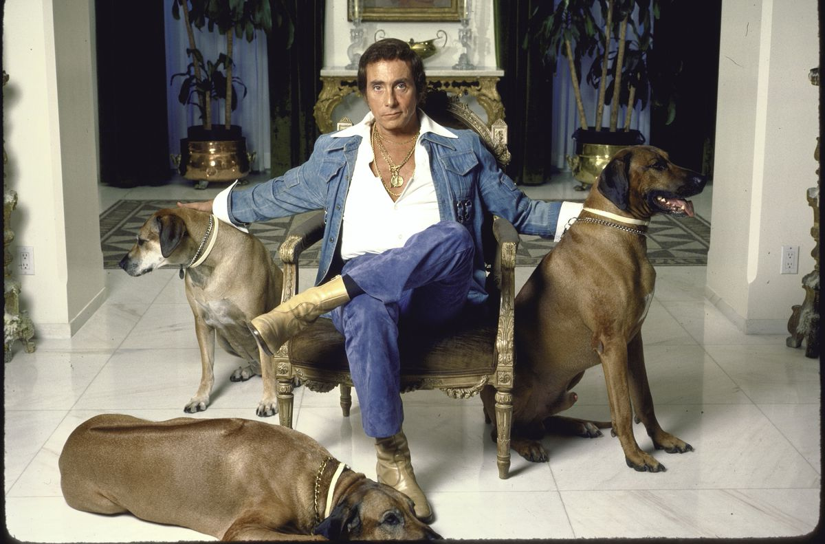 Penthouse publisher Bob Guccione with three dogs