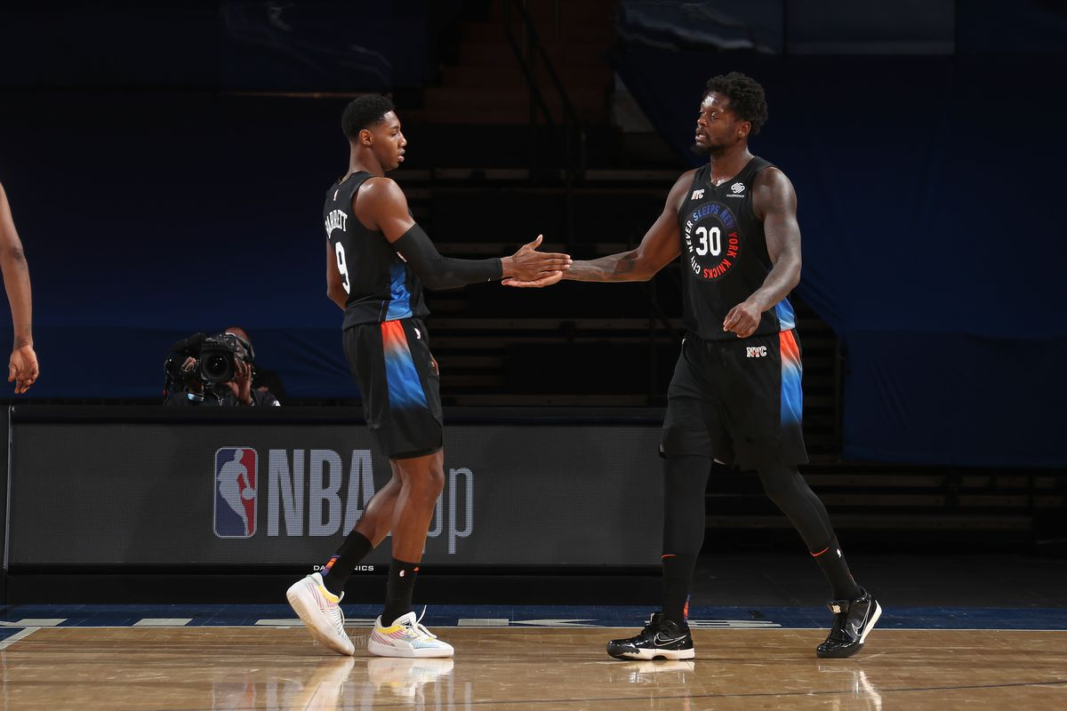Julius Randle hi-fives RJ Barrett of the New York Knicks during the game against the Brooklyn Nets on January 13, 2021 at Madison Square Garden in New York City, New York.