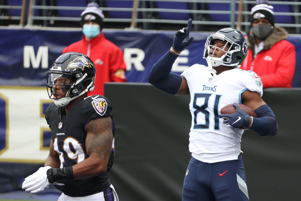 Jonnu Smith #81 of the Tennessee Titans celebrates his first quarter touchdown against the Baltimore Ravens during the game at M&T Bank Stadium on November 22, 2020 in Baltimore, Maryland.