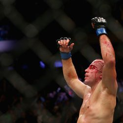 St-Pierre raises his hands to the cheers of a packed Madison Square Garden.