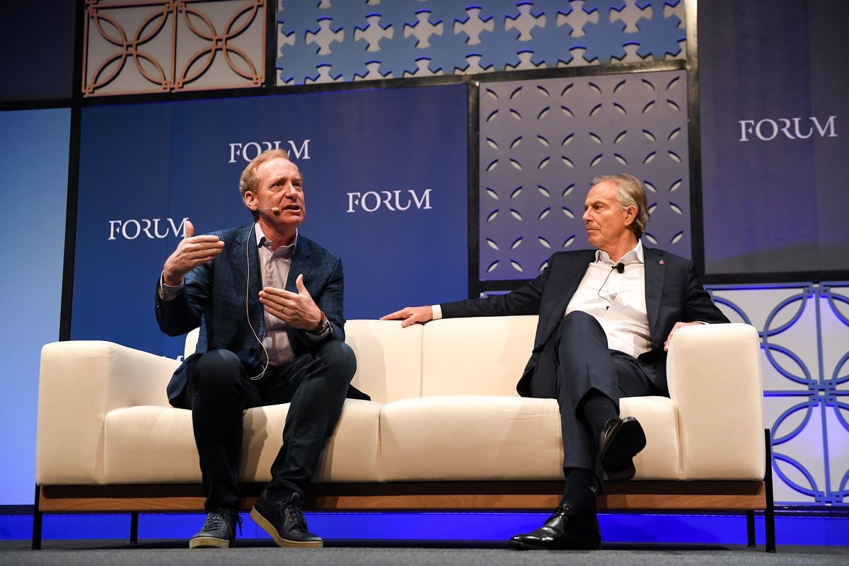 Microsoft President Brad Smith, left, and former British Prime Minister Tony Blair onstage at the Web Summit