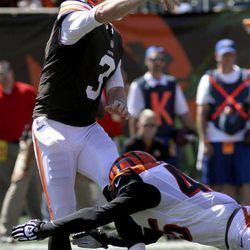 Cleveland Browns quarterback Brandon Weeden (3) throws under pressure from Cincinnati Bengals defensive back Jeromy Miles (45) in the first half of an NFL football game, Sunday, Sept. 16, 2012, in Cincinnati.