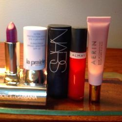 Some makeup musts: <strong>La Prairie Ultra Protection Stick SPF 40</strong> (so easy to apply and never makes me break out), <strong>Almay lip gloss</strong> (for a sheer pop of color), and <strong>Aerin Rose Lip Conditioner</strong> (heavenly!).