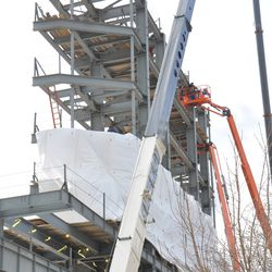 Tarps covering the installation of the left field video board -