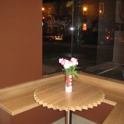 Some seating available in the shop's bay window space