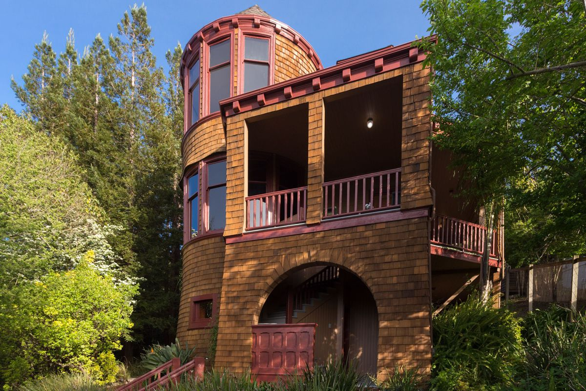 A Queen Anne home with turret, covered in redwood shingling.