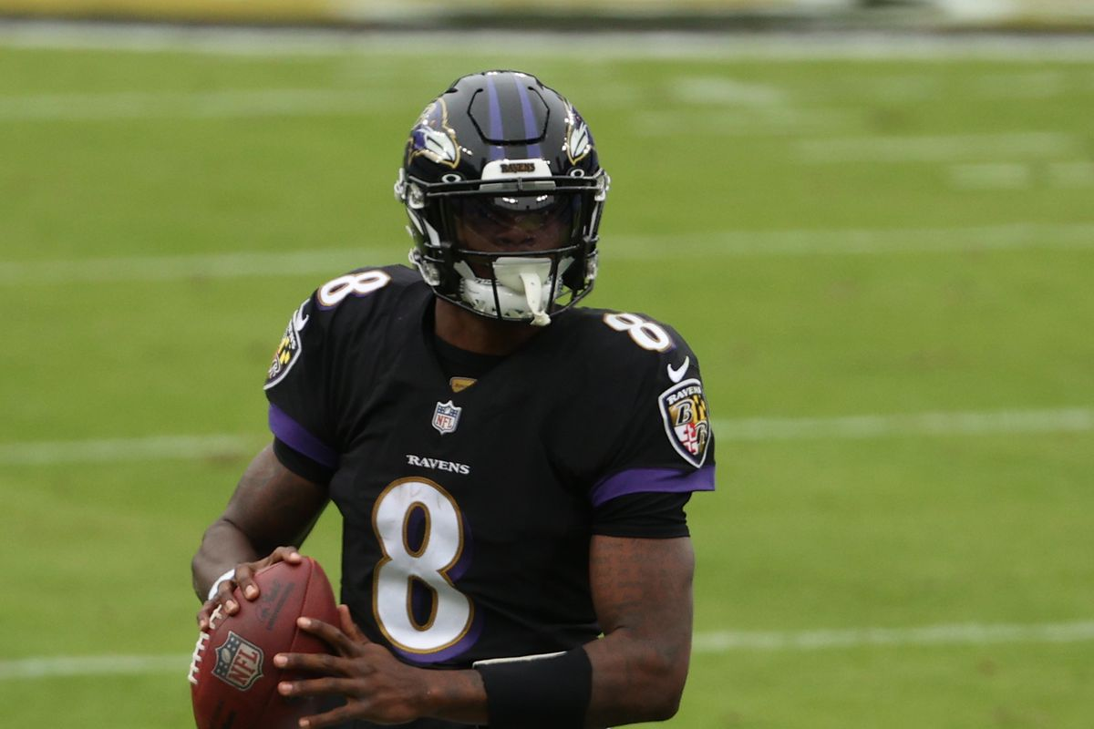Quarterback Lamar Jackson #8 of the Baltimore Ravens passes the ball against the Tennessee Titans at M&T Bank Stadium on November 22, 2020 in Baltimore, Maryland.
