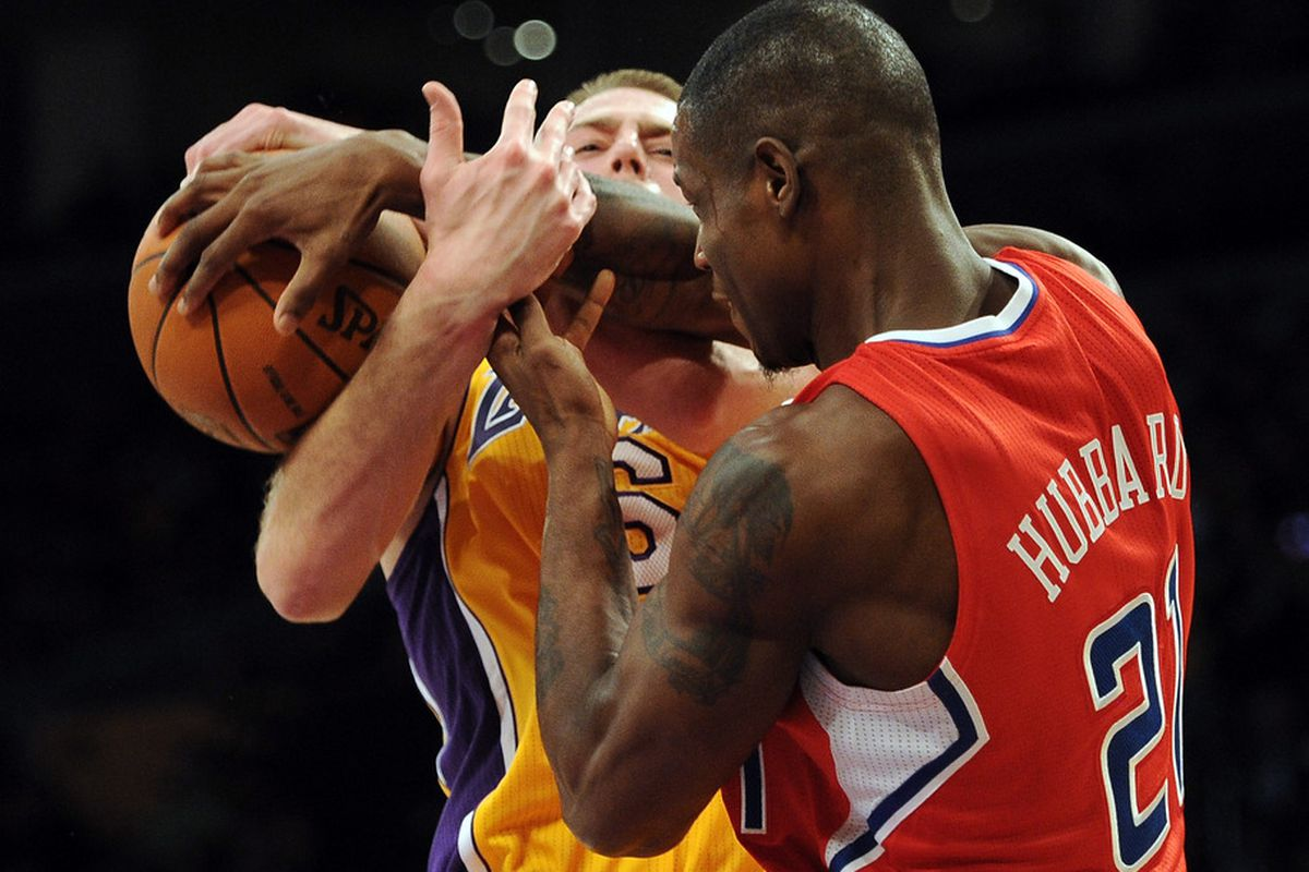 LOS ANGELES, CA - DECEMBER 19:  Josh McRoberts #6 of the Los Angeles Lakers takes the ball away from Marcus Hubbard #21 of the Los Angeles Clippers at Staples Center on December 19, 2011 in Los Angeles, California.  (Photo by Harry How/Getty Images)