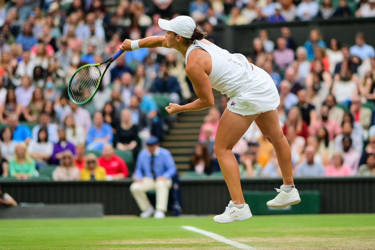 Ashleigh Barty of Australia serves against Ajla Tomljanovic of Australia in the quarter finals of the ladies singles during Day Eight of The Championships - Wimbledon 2021 at All England Lawn Tennis and Croquet Club on July 06, 2021 in London, England.
